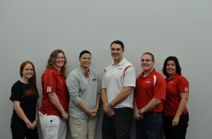 Maris (right) and her Snap Fitness family