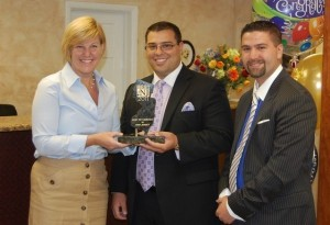 Fanwood, NJ Mayor Colleen Mahr awarding Steve (center) and Jason Parker the NJ Monthly Award