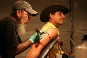 Anytime Fitness CEO Chuck Runyon's Running Man Tattoo Photo